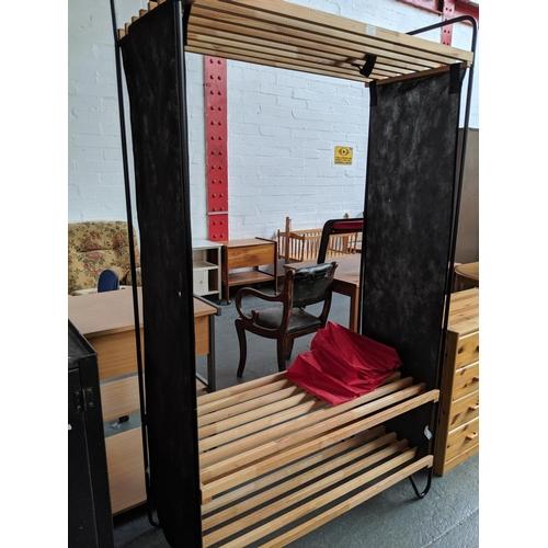547 - A Ikea shoe and clothes rail...