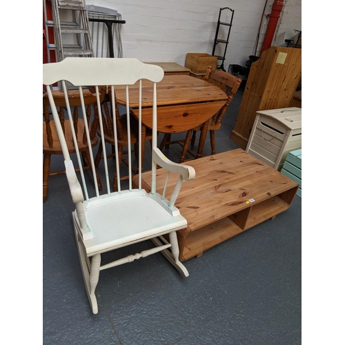 553 - A painted white rocking chair and pine coffee table...