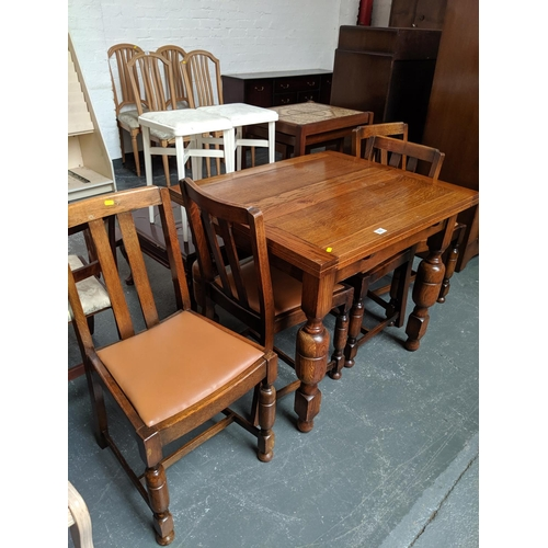 560 - Extending dining table and four chairs...