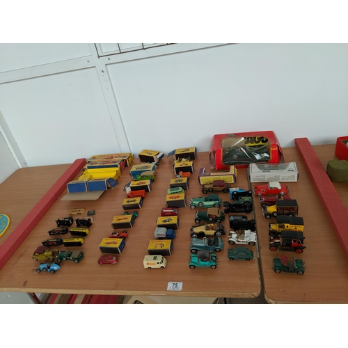 75 - A collection of Matchbox, Burago, Models of Yesteryear cars and five empty Matchbox boxes...