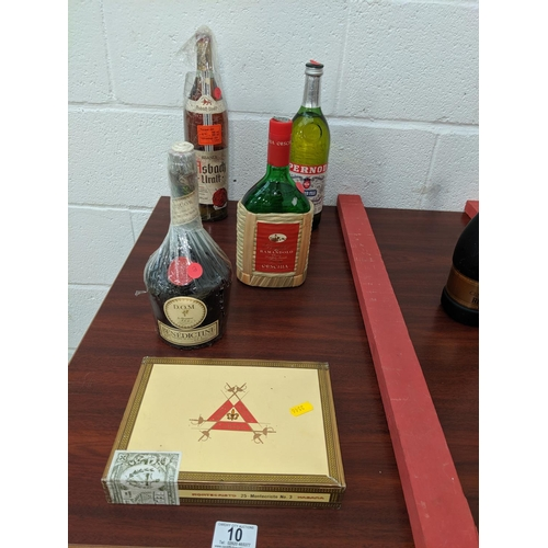 10 - A bottle of Grappa , Benedectine, Asb Ach brandy, Pernod and a box of Monte Cristo Habana cigars...