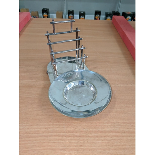54 - Mappin & Webb Aesthetic Movement silver plated bachelors toast rack with butter dish raised on four ...
