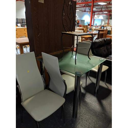 714 - A metal chair and a glass dining table with four chairs...