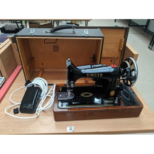 22 - A 99k Singer sewing machine with case and foot...