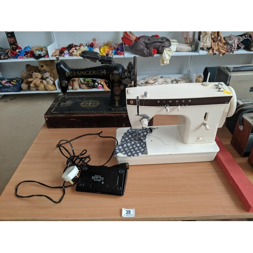 39 - A Singer hand crank sewing machine and an electric sewing machine...