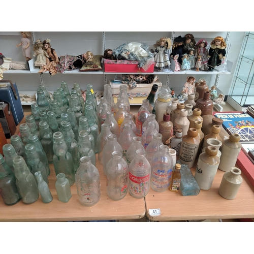 41 - A selection of vintage bottles including stone...