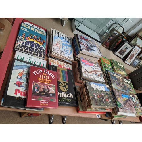 42 - A quantity of Giles books, Punch magazines and Punch books...