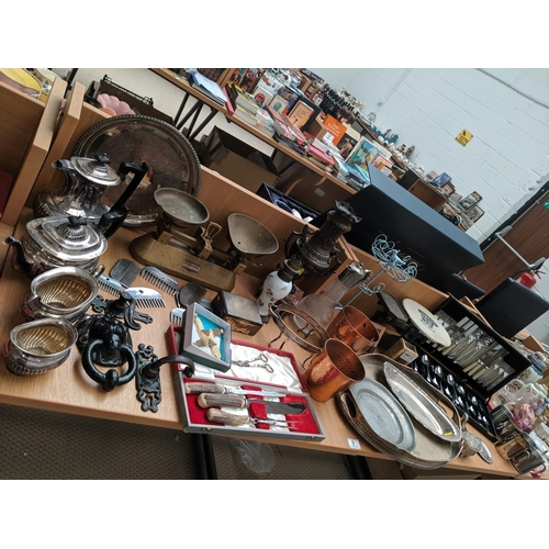 9 - A large collection of metalware including silver plated tray, flatware, scales etc....