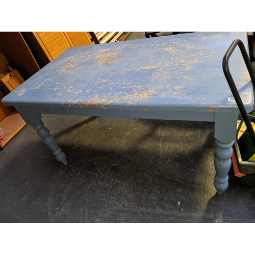 685 - A painted blue pine dining table...