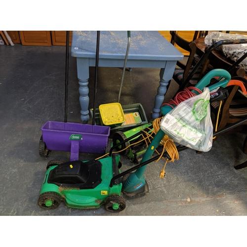 686 - A Powerbase lawn mower, garden items etc....
