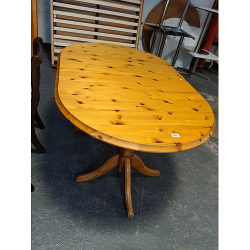688 - A pine dining table...