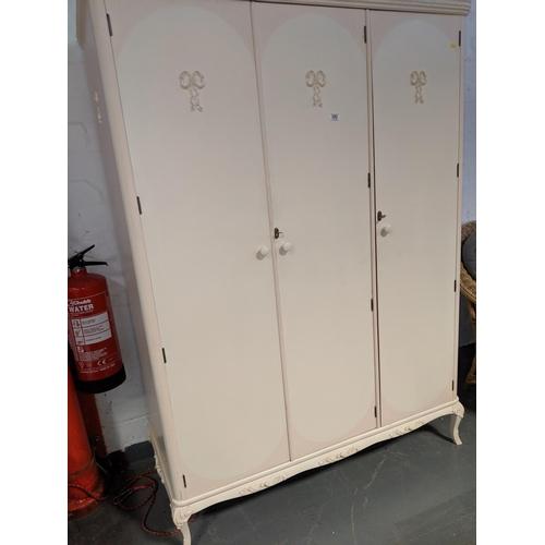 690 - A triple door painted wardrobe...
