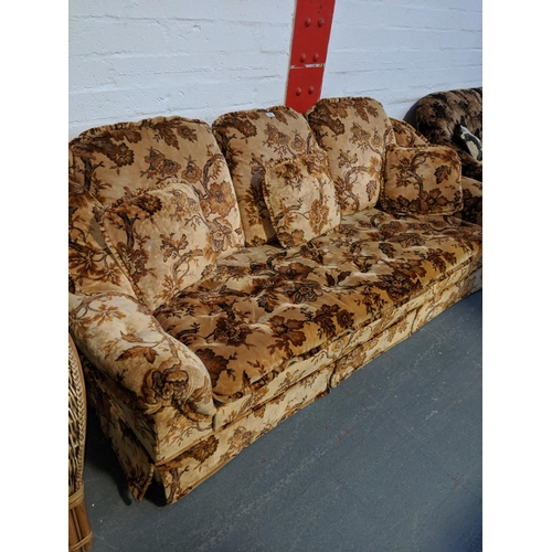 692 - A retro three seater sofa...