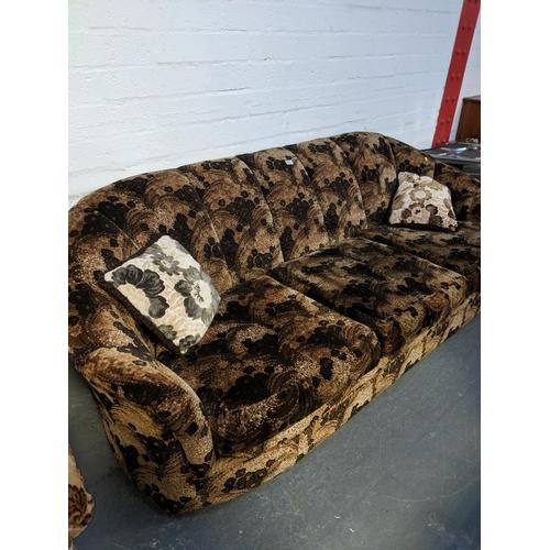 693 - A retro three seater sofa...