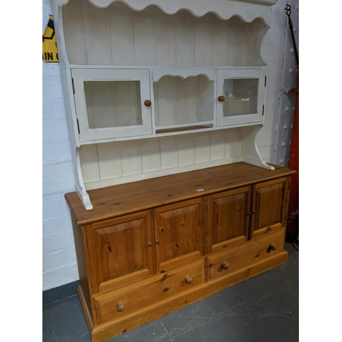 696 - A pine dresser with painted top...