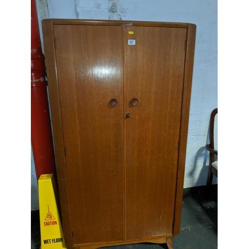 697 - An Austin suite teak wardrobe...