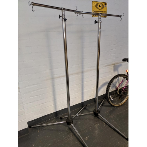 701 - Two commercial clothes rail...
