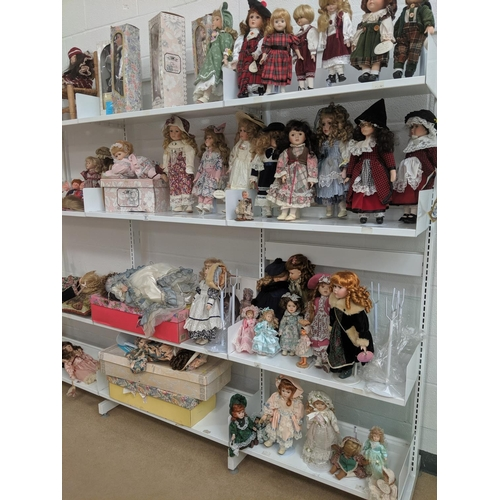 51 - A large quantity of dolls - 8 shelves including Leonardo Collection, doll stands etc....