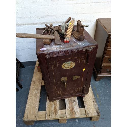760A - A cross bros limited Cardiff safe with key ( in office) , 56lb weight, iron tools etc....