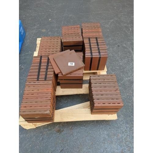 754 - A quantity of quarry tiles...