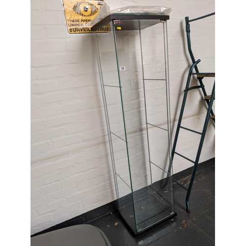 769 - A glass display cabinet with three shelves...