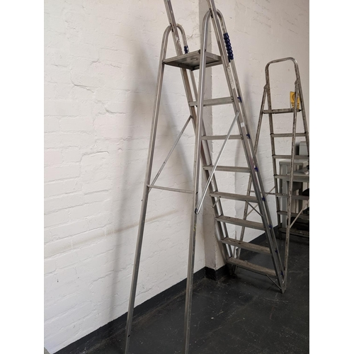 771 - Two sets of aluminum step ladders...