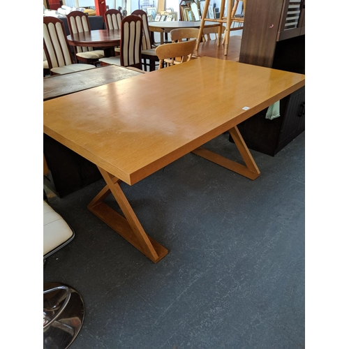784 - A wooden dining table...