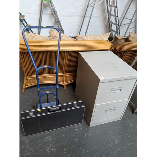 796 - A sack truck/trolley, a two drawer metal filing cabinet and a pentax camera case...