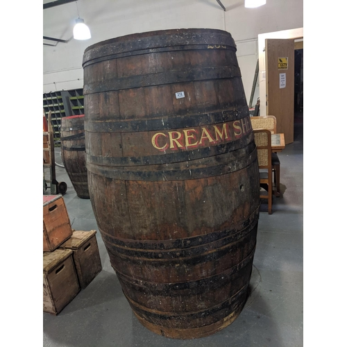218 - An extremely large oak sherry barrel- 68 inches tall, sign written- cream sherry...