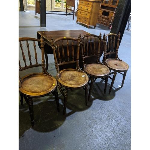 206 - A set of four farmhouse chairs...