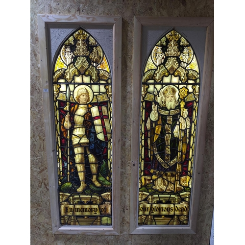 223 - A pair of stained glass windows- In Memory of Our Glorious Dead' each panel measuring 19 inches wide...