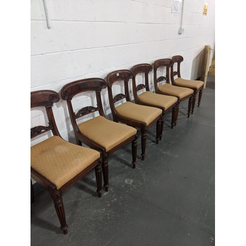 204 - A set of six mahogany,regency bar back dining chairs with carved back bar and reeded legs...