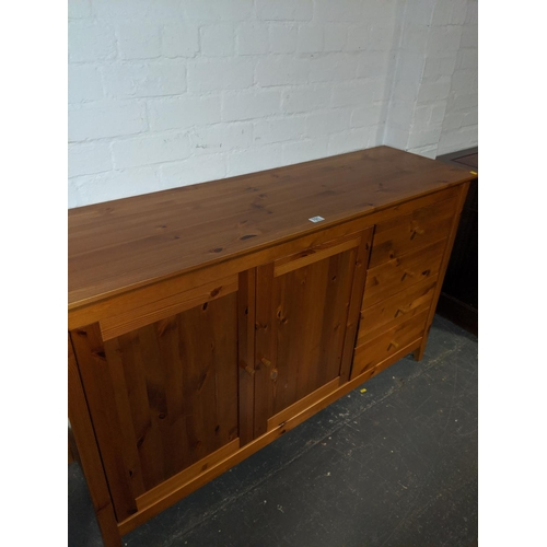 761 - A pine sideboard...