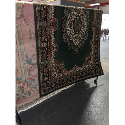 778 - Two machine made carpets including a Chinese...