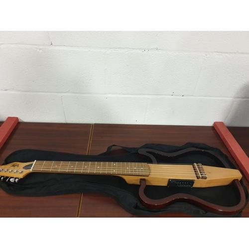 34 - A Woody Zodiac Pro Series skeleton guitar and guitar bag...