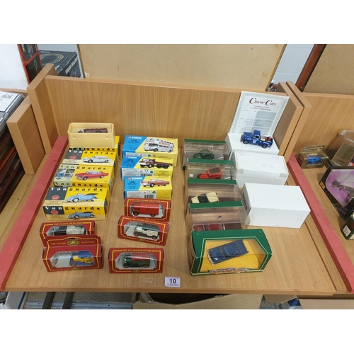 10 - Four Vanguards boxed model cars, three boxed Corgi Classics and various other boxed model cars...