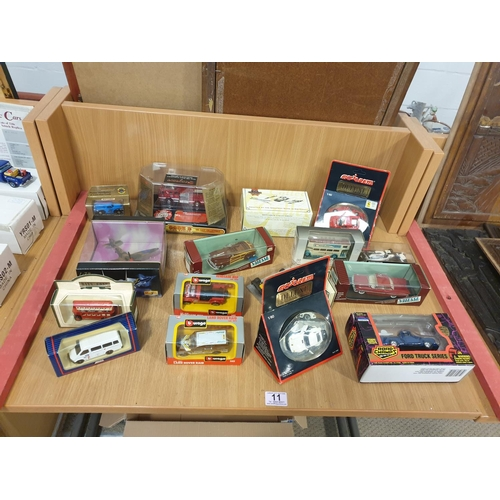 11 - An assorted collection of boxed model cars to include Burago, Vitesse, Days Gone, etc...