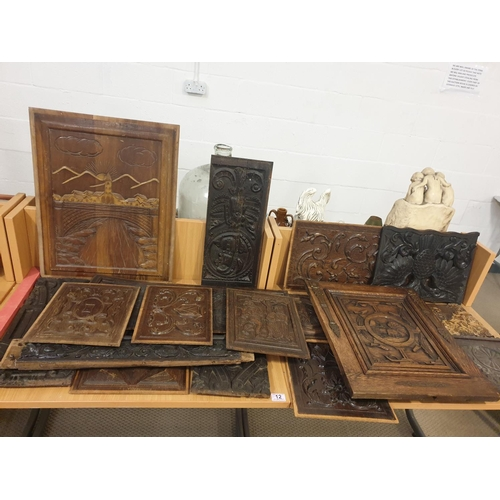 12 - A quantity of early, carved wooden furniture panels...