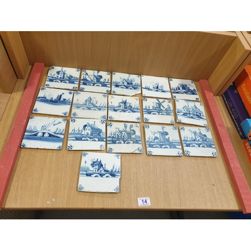 14 - A collection of early blue and white Delft tiles...