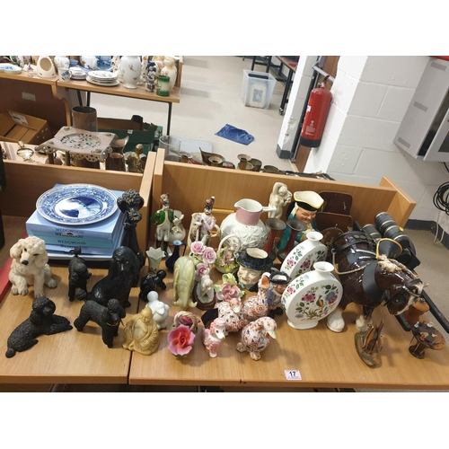 17 - A quantity of china to include ornaments, Wedgwood plates, onyx bull etc...
