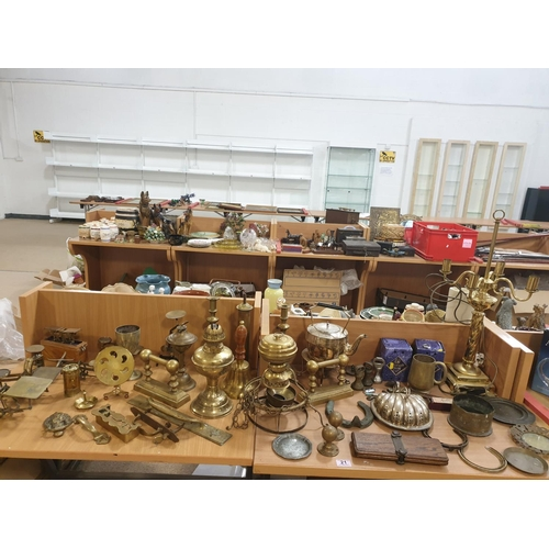 21 - A collection of brass and metalware to include scales, a bell, lamps, etc...