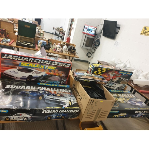 3 - Four full Scalextric boxed sets and extra track, cars, etc...