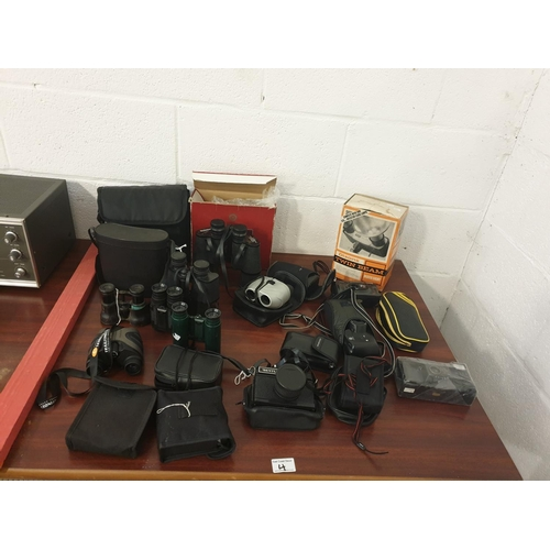4 - A collection of cameras and binoculars...