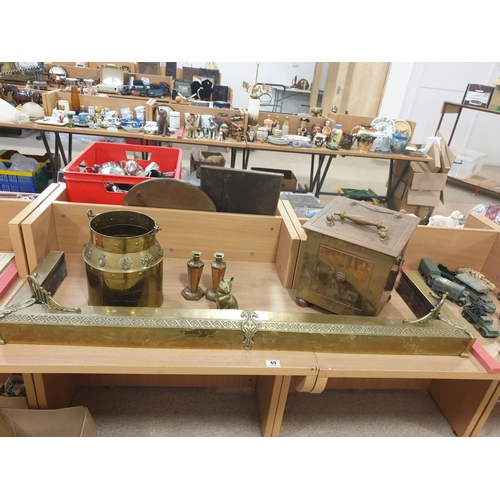 40 - A brass fender and other brassware...