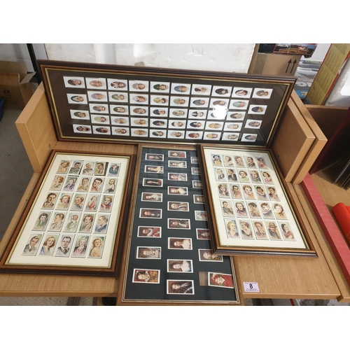 8 - A collection of framed cigarette cards...