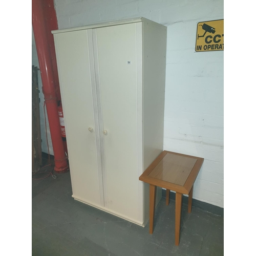 804 - A double wardrobe and a glass top coffee table...