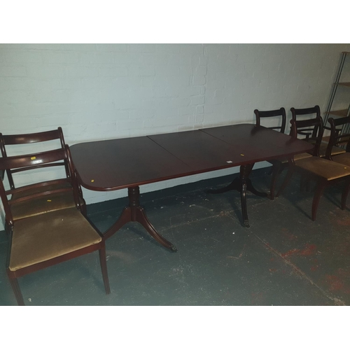 814 - A Regency style twin pedestal table and six chairs...