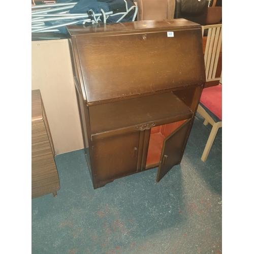 820 - A wooden writing bureau...