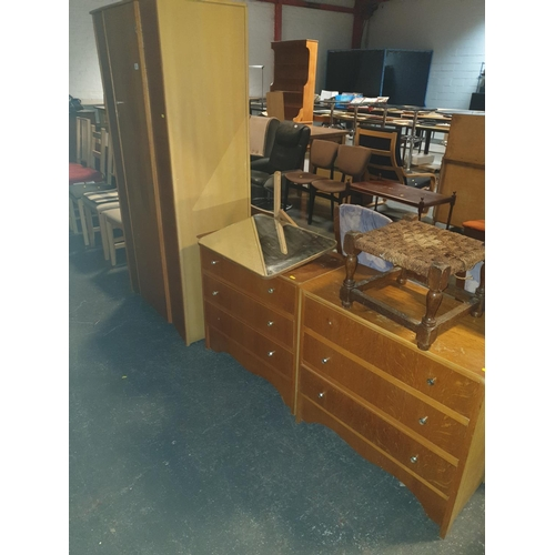 822 - A matching wardrobe, dressing table, and a chest of drawers...