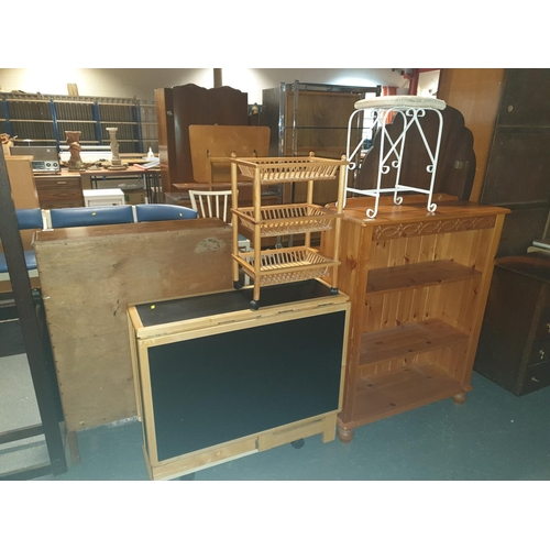 825 - A pine bookcase, dropleaf dining table, etc...